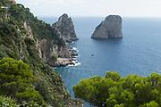 View of Il Faraglioni rock outcroppings off the coast of Capri Island, Italy