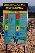 Notice sign of beach rules for area specially for dogs, Corralejo, Fuerteventura, Canary Islands, Spain