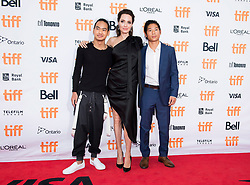 "Left to right, Maddox Jolie-Pitt, Angelina Jolie and Pax Jolie-Pitt pose for photographs on the red carpet for the movie ""First They Killed My Father"" during the 2017 Toronto International Film Festival in Toronto, ON, Canada, on Monday, September 11, 2017. Photo by Nathan Denette/CP/ABACAPRESS.COM"