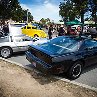 Replica of KITT from Knight Rider, parked next to a DMC DeLorean.