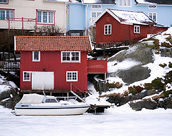 View of  traditional harbour and village of Kladesholmen during winter on Bohuslan coast in Sweden
