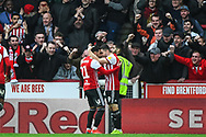 Brentford Forward Said Benrahma (21) celebrates scoring a goal (2-0) during the EFL Sky Bet Championship match between Brentford and Queens Park Rangers at Griffin Park, London, England on 2 March 2019.