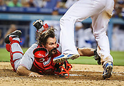 LOS ANGELES, USA, JUL 26: Cincinnati Reds catcher Corky Miller, bottom, tags out Los Angeles Dodgers shortstop Hanley Ramirez at the plate in the fourth inning during a Major League Baseball game at Dodgers Stadium in Los Angeles, USA, on July 26, 2013. (EDITORIAL USE ONLY)<br /> Photographer: Penta Press/Bret Hartman