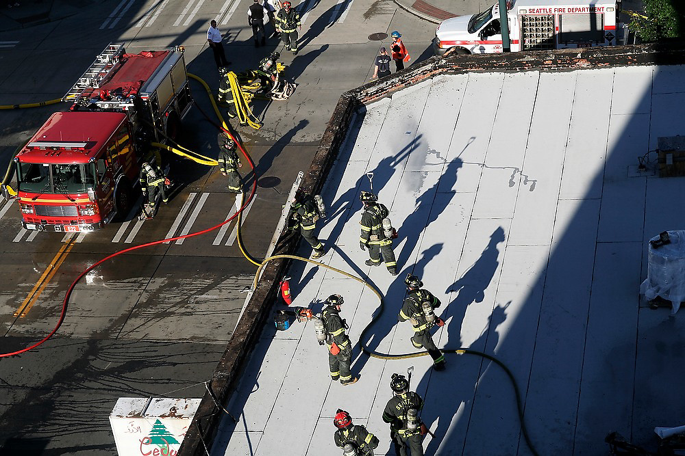 Seattle firefighters respond to a kitchen fire that erupted through to the roof of Flowers Bar & Restaurant in the Univer District, Seattle, Washington on June 25, 2007. Only minor damage was caused by the fire and Flowers reopened a few days later.