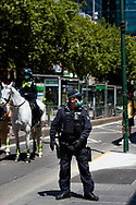 A Public Order Response officer is seen standing during the Melbourne Freedom Rally at Parliament House. Police move into position on the steps of state parliament ahead of a planed protest. The groups who have organised the many Freedom Day protests over the last 3 months, attempted to march on State Parliament during Melbourne Cup Day demanding the sacking of Premier Daniel Andrews for the lockdown and attacks on their civil liberties. Police met with the protester's with significant force despite the city having had zero cases for five days. (Photo by Dave Hewison/Speed Media)