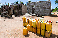 Cannisters of freshwater for sale at a rural market, Quifuki Island, Mozambique