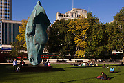 Artist Nic Fiddian-Green's giant 30ft bronze 'Marwari Horse at Water' sculpture which stands at London's Marble Arch. Seated beneath this huge piece of scaled equine head are young people, leaning and sitting on the horse's plinth. This is a popular stopping off place for those enjoying late summer temperatures. The head stands on the end of its nose, a balancing act effective as a standalone piece of art that represents the carrying of wounded masters to safety that had an extraordinary resonance for the artist. Commissioned to create the piece by JCB founder Sir Anthony and Lady Bamford in January 2006 – just after Fiddian-Green had been diagnosed as suffering from a rare form of leukaemia. The Marwari breed was famous in India for centuries as the mount of the Rajput cavalry.