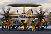 "Description  E-2C Hawkeye 2000 NP.The E-2 Hawkeye is the Navy's all-weather, carrier-based tactical battle management airborne early warning, command and control aircraft. The E-2 is a twin engine, five crewmember, high-wing turboprop aircraft with a 24-foot diameter radar rotodome attached to the upper fuselage...Features.The Hawkeye provides all-weather airborne early warning, airborne battle management and command and control functions for the Carrier Strike Group and Joint Force Commander. Additional missions include surface surveillance coordination, air interdiction, offensive and defensive counter air control, close air support coordination, time critical strike coordination, search and rescue airborne coordination and communications relay. An integral component of the Carrier Strike Group air wing, the E-2C uses computerized radar, Identification Friend or Foe and electronic surveillance sensors to provide early warning, threat analysis against potentially hostile air and surface targets...Background.The continuous improvements in early airborne radars by 1956 led to the concept of an airborne early warning and command and control aircraft. The first aircraft to perform this mission was the Grumman E-1 Tracer (a variant of the S-2 Tracker anti-submarine aircraft), which saw service from 1954 to 1964. The E-1's successor, the E-2 Hawkeye, was the first carrier-based aircraft designed from the outset for the all-weather airborne early warning and command and control mission. Since replacing the E-1 in 1964, the Hawkeye has been the ""eyes of the fleet."" Since its combat debut during the Vietnam conflict, the E-2 has served the Navy around the world. ..Hawkeyes directed F-14 Tomcat fighters flying combat air patrol during the two-carrier battle group joint strike against terrorist-related Libyan targets in 1986. In the early 1990s, E-2s provided airborne command and control for successful Coalition Air Operations during the first Arabian Gulf War. Directing both"