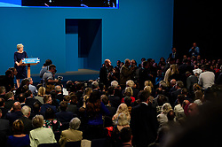 © Licensed to London News Pictures. 04/10/2017. Manchester, UK. A protestor is removed from the hall (pictured right)  during a speech by British prime minister THERESA MAY on the final day of the Conservative Party Conference. The four day event is expected to focus heavily on Brexit, with the British prime minister hoping to dampen rumours of a leadership challenge. Photo credit: Ben Cawthra/LNP