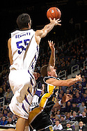Kennesaw State guard Golden Ingle (R) drives and scores past Kansas State center Jason Bennett (55) in the first half at Bramlage Coliseum in Manhattan, Kansas, December 17, 2006.  K-State beat Kennesaw State 82-54.<br />
