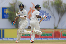 July 26, 2017 - Galle, Sri Lanka - Indian cricketers Shikhar Dhawan and Cheteshwar Pujara run between the wickets during the 1st Day's play in the 1st Test match between Sri Lanka and India at the Galle International cricket stadium, Galle, Sri Lanka on Wednesday 26 July 2017. (Credit Image: © Tharaka Basnayaka/NurPhoto via ZUMA Press)