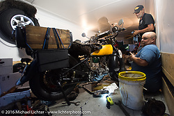 Major repairs going on Rich Rau's 1936 Harley Davidson R in his trailer after the hosted stop at Coker Tires in Chattanooga, Tennessee after the finish of stage 3 of the Motorcycle Cannonball Cross-Country Endurance Run, which on this day ran from Columbus, GA to Chatanooga, TN., USA. Sunday, September 7, 2014.  Photography ©2014 Michael Lichter.