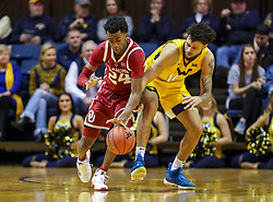 Feb 2, 2019; Morgantown, WV, USA; Oklahoma Sooners guard Jamal Bieniemy (24) steals the ball from West Virginia Mountaineers guard Jermaine Haley (10) during the first half at WVU Coliseum. Mandatory Credit: Ben Queen-USA TODAY Sports