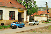 In the village Mad in Tokaj: two cars in front of a grocery shop: old and new meeting: an old Trabant and a modern car. Mad is one of the main villages in the Tokaj district.  Credit Per Karlsson BKWine.com