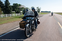 Doc Hopkins with Lyn Jevicky in the sidecar of his 1916 Harley Davidson J model and his daughter Kersten on her '22 Harley-Davidson J model behind on the Motorcycle Cannonball coast to coast vintage run. Stage 8 (314 miles) from Spirit Lake, IA to Pierre, SD. Saturday September 15, 2018. Photography ©2018 Michael Lichter.