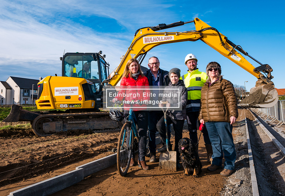 East Lothian Core Paths, Gullane, East Lothian, Scotland, United Kingdom, 07 February 2020. Construction has started on a pedestrian and cycle path to connect Gullane and West Fenton villages. The longest running campaign of its kind in Scotland, activists have lobbied for 15 years for an off-road route, away from a dangerous main road, to link Gullane and Drem. After reaching agreement with landowners, housing company CALA Homes is funding a one mile section of the path between Gullane and West Fenton. Pictured (L t R): Clare Cavers, local cyclist, Iain Monk, Campaign Spokesman, Rowan McLaughlin, aged 10 years, Jordon McKenna, Cala site manager & Jackie Buchan with Jess, local residents.<br /> Sally Anderson | EdinburghElitemedia.co.uk