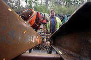 Welders are at work at the Unity Mine complex, on Thursday, Apr. 12, 2007, in Cwmgwrach, Vale of Neath, South Wales. The time is ripe again for an unexpected revival of the coal industry in the Vale of Neath due to the increasing prize and diminishing reserves of oil and gas, the uncertainties of renewable energy sources, and the technological advancement in producing energy from coal while limiting emissions of pollutants, has created the basis for valuable investment opportunities and a possible alternative to the latest energy crisis. Unity Mine, in particular, has started a pioneering effort to revive the coal industry in the area, reopening after more than 8 years with the intent of exploiting the large resources still buried underground. Coal could be then answer to both, access to cheaper and paradoxically greener energy and a better and safer choice than nuclear energy as a major supply for the decades to come. It is estimated that coal reserves in Wales amount to over 250 million tonnes, or the equivalent of at least 50 years of energy supply, while the worldwide total coal could last for over 200 years as a viable resource compared to only a few decades of oil and natural gas...