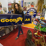 PADOVA, ITALY - OCTOBER 27:  An employee moves a traditional vintage Goodyear sign on October 27, 2011 in Padova, Italy. The Vintage and Classic Cars Exhibition of Padova, running from the October 28 - 30, is the most important European trade show for vintage cars and motorbikes, showcasing over 1600 vehicles.