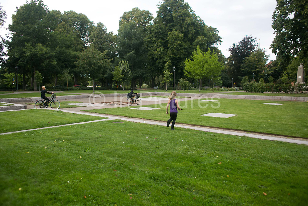 Children playing Pokemon GO head for a collection point in a park in Landskrona, Swede, 28th of August 2016.