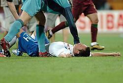 25-06-2006 VOETBAL: FIFA WORLD CUP: NEDERLAND - PORTUGAL: NURNBERG<br /> Oranje verliest in een beladen duel met 1-0 van Portugal en is uitgeschakeld / HEITINGA John <br /> ©2006-WWW.FOTOHOOGENDOORN.NL