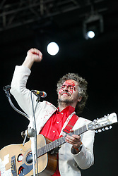 Wayne Coyne, lead singer of the American rock band The Flaming Lips, play on the main stage at T in the Park, 12/7/2003..Pic: © Michael Schofield.