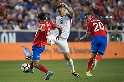 September 1, 2017 - Harrison, New Jersey, U.S - Costa Rica midfielder CELSO BORGES (5) steals the ball from USMNT forward BOBBY WOOD (9) while Costa Rica midfielder DAVID GUZMçN (20) looks on during a World Cup qualifier match at Red Bull arena in Harrison, NJ.  Costa Rica defeats USA 2 to 0. (Credit Image: © Mark Smith via ZUMA Wire)