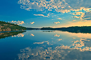 CLouds reflected in White Lake <br />Flin Flon<br />Manitoba<br />Canada