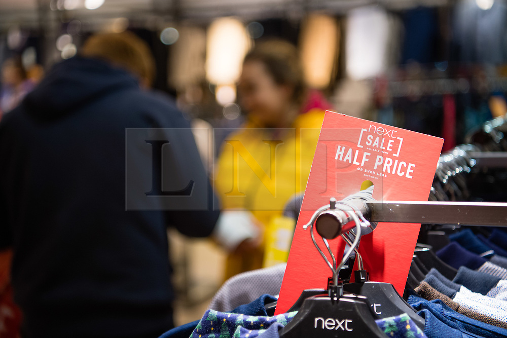 © Licensed to London News Pictures. 26/12/2017. Aberystwyth, Wales, UK. Shoppers looking for bargains on clothes, traveled for up to an hour to be in Aberystwyth early on Boxing Day for the 6am opening of the Next store's annual sale. Photo credit: Keith Morris/LNP