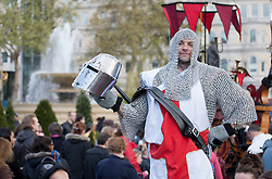 © licensed to London News Pictures. London, UK 21/04/2012. A templar look-like posing in Trafalgar Square as the London landmark transformed into an English garden ahead of St George's Day. Photo credit: Tolga Akmen/LNP