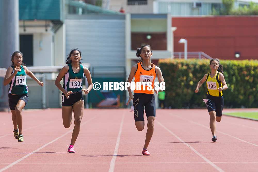 Ismi Zakiah Bte Kashful Anwar (#40), Tanisha Moghe (#130) and mirah Aljunied (#101) in action during the A Division girls' 200 metres finals. Ismi Zakiah clinched the gold with a timing of 26.09 seconds. (Photo © Jerald Ang/Red Sports)