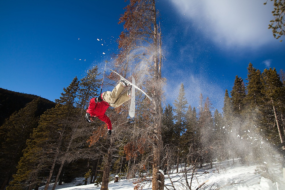 Daan Stevenson does a backflip off of a jump during a ski tour with the University of Colorado Backcountry Club to Jenny Lind Gulch, Arapaho National Forest, Colorado.