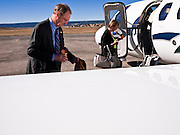 31 OCTOBER 2010 - WINDOW ROCK, AZ: Terry Goddard gets ready to board the campaign plane before a flight from Window Rock to Kingman. Goddard, and the other Democrats on the statewide ticket, campaigned in Window Rock and Kingman on Halloween. Goddard ended the day with a press conference in front of the Executive Office Tower at the State Capitol in Phoenix. Goddard lost the election to sitting Governor Jan Brewer, a conservative Republican.     PHOTO BY JACK KURTZ