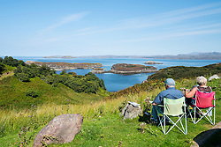 Tourists enjoy view from Drumbeg Viewpoint towards Eddrachillis Bay,Sutherland, Scotland, United Kingdom