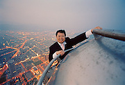 Hong-Ming Lin (also know as Harace Lin) head of the owner consortium of Taipei 101, the world's tallest building was his brain-child and life-long project.  Harace is shown here at the top of the 1667 feet, 508m building.