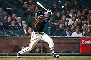 San Francisco Giants second baseman Josh Rutledge (19) bats against the Oakland Athletics at AT&T Park in San Francisco, California, on March 26, 2018. (Stan Olszewski/Special to S.F. Examiner)