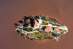 Island with church on lake and severe algal blooms on Lake Bled, on March 19, 2020 in Bled, Slovenia. Photo by Matic Klansek Velej / Sportida