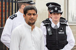 ** PREVIOUSLY UNSEEN PICTURE** © Licensed to London News Pictures . London , UK . SIDDHARTHA DHAR (c) at a Muslims Against Crusades demonstration in Walthamstow in London on 30th July 2011 . Dhar , also known as Abu Rumaysah , is to appear in a Channel 4 documentary , The Jihadis Next Door , this evening (Tues) . It is believed Dhar is the 'New Jihadi John', one of five executioners to have featured in a recent ISIS video. Photo credit : Joel Goodman/LNP .