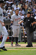 CHICAGO - JULY 27:  Miguel Cabrera #24 of the Detroit Tigers argues with home plate umpire Derryl Cousins #13 after being called out on strikes against the Chicago White Sox on July 27, 2011 at U.S. Cellular Field in Chicago, Illinois.  The White Sox defeated the Tigers 2-1.  (Photo by Ron Vesely)  Subject: Miguel Cabrera;Derryl Cousins