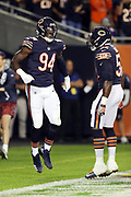 Chicago Bears outside linebacker Leonard Floyd (94) leaps and celebrates with Chicago Bears inside linebacker Christian Jones (52) after sacking Minnesota Vikings quarterback Sam Bradford (8) in the end zone for a first quarter safety and a 2-0 Bears lead during the 2017 NFL week 5 regular season football game against the against the Minnesota Vikings, Monday, Oct. 9, 2017 in Chicago. The Vikings won the game 20-17. (©Paul Anthony Spinelli)