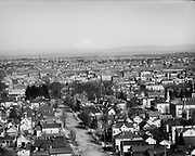 view of downtown N/NE from location of today's SW Hoffman Avenue. Seventh Avenue (later Broadway) is the street visible in the center leading into town. First intersection in foreground appears to be SW College Street.  Taken from same location but using longer lens than UO578. Ca. 1912.