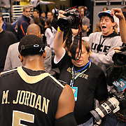 University of Central Florida guard Marcus Jordan (5) exits the court to the throng of media members after taking on the Florida Gators at the Amway Center on December 1, 2010 in Orlando, Florida. Central Florida won the game 57-54 for their first ever victory against a nationally ranked team. (AP Photo/Alex Menendez)