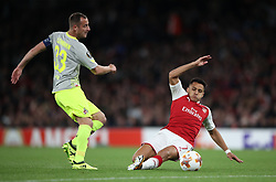 Arsenal's Alexis Sanchez (right) and FC Koln's Mathias Lehmann battle for the ball during the Europa League match at the Emirates Stadium, London.