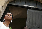Leader of the House of Lords Baroness Valerie Amos stands in the door of return at the former slave fort of Cape Coast Castle in Cape Coast, Ghana, on Sunday Mar 4, 2007. Amos was visiting on the occasion of the 200th anniversary of the abolition of slave trade, which coincides with Ghana's 50th anniversary of independence. The door of return is the same gateway used by slaves as they left Africa for the New World - it is now being used by descendants of slaves who are returning to Africa.