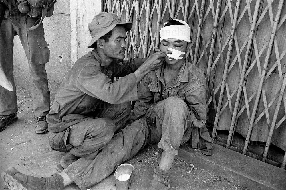 A Viet cong prisoner being fed in beleaguered town of Xuan Loc in final days of Vietnam War April 1975. The Vietnam War was fought between 1st November 1955 until the fall of Saigon on 30th April 1975. Photographed by Terry Fincher.