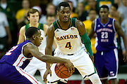 WACO, TX - DECEMBER 18: Gary Franklin #4 of the Baylor Bears defends against the Northwestern State Demons on December 18 at the Ferrell Center in Waco, Texas.  (Photo by Cooper Neill) *** Local Caption *** Gary Franklin
