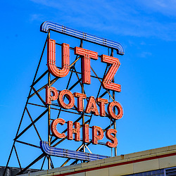 Hanover, PA / USA - February 19, 2020: The iconic Utz Potato Chip sign on the factory and outlet building in Hanover.