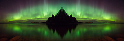 """""""Aurora Island"""" is included in the NANPA 2018 Showcase publication """"Expressions"""". This Aurora Borealis and its reflection is a flipped image creating a fantasy island in the north. It was taken in Saskatchewan, Canada."""
