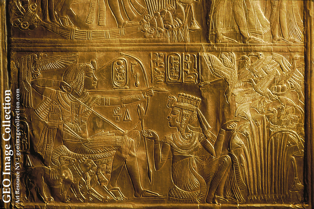 Detail of hunting birds with bow and arrow on Canopic Shrine, gold, King Tutankhamun; Egypt; New Kingdom; Tutankhamun; Valley of the Kings; Tut; Tomb; Gold; Canopic Shrine