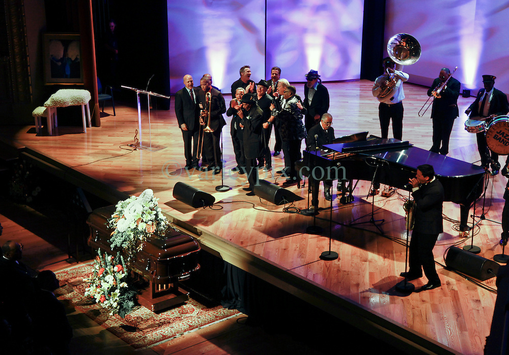 20 November 2015. Orpheum Theater, New Orleans, Louisiana. <br /> Memorial service for musician Allen Toussaint. <br /> Musicians and other VIP's take to the stage for a rousing end to the service. On stage were Mayor Mitch Landrieu, Deacon John, Eric Paulsen, Jimmy Buffet, Boz Skaggs, Jon Cleary, Mac Rabennack (Dr John), Troy 'Trombone' Shorty and the Preservation Hall Jazz band amongst others.<br /> Photo; Charlie Varley/varleypix.com