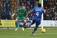 AFC Wimbledon defender Deji Oshilaja (4) with a chance during the EFL Sky Bet League 1 match between AFC Wimbledon and Northampton Town at the Cherry Red Records Stadium, Kingston, England on 10 February 2018. Picture by Matthew Redman.